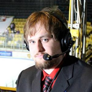 Lee W. Mowen, preparing to broadcast a Dayton Demonz hockey game.